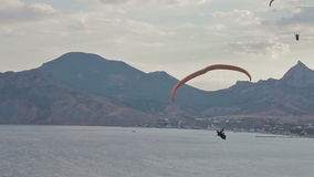 Paragliders ridge soaring, ridge lift stock footage
