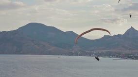 Paragliders ridge soaring, ridge lift stock footage