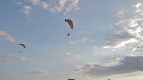 Paragliders ridge soaring, ridge lift stock video footage