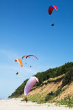 Paragliders at the sea shore Stock Images