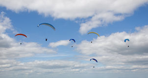 Paragliders soaring high in the sky Royalty Free Stock Images