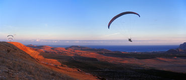 Paragliders at sunset. Royalty Free Stock Photos