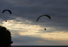 Paragliders at Sunset Royalty Free Stock Photo