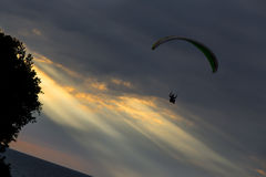 Paragliders at Sunset Stock Images