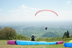 Paragliders taking off Stock Images