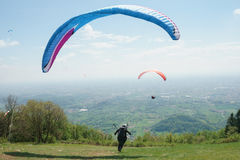 Paragliders taking off Royalty Free Stock Photo