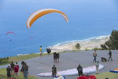 Paragliders wait in line for take-off in Les Colimatons Les Hauts De Reunion, France. Royalty Free Stock Image