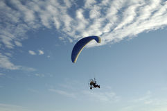 Paragliding 10. Paragliding pilots in the air with clouds in the background Royalty Free Stock Images