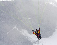 Paragliding. Paraglider teacher and studends flying in alps with woods in background Royalty Free Stock Photography