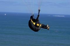 Paragliding. Men doing paragliding over the sea Stock Photos