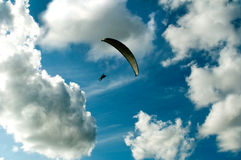 Paragliding. In blue cloudy sky royalty free stock images