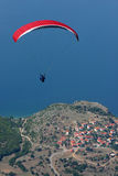Paragliding. Red paraglider above ohrid lake Royalty Free Stock Photos