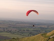 Paragliding. Paraglider flying over the English countryside royalty free stock photo