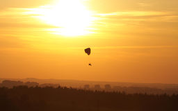 Paragliding. Powered paragliding against the background of the setting sun stock photo