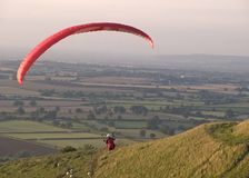 Paragliding 2. Paraglider flying over the countryside stock photo