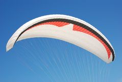Paragliding. Parachute against bright blue sky Stock Image