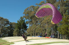 Paragliding. The mountain over looking Bright in Victoria Australia, is a great place for this sport. On most days you will see people flying high up over the Stock Image