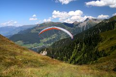 Paragliding. Image of a paraglider starting from mountain in Austrian Tirol Royalty Free Stock Images