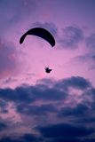 Paragliding. Black silouette of paragliding in a sunset Royalty Free Stock Images