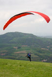 Paragliding. Paraglider just started his flight Royalty Free Stock Image