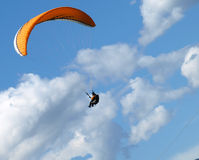 Paragliding. A wonderful shot of a paragliding athlet through the clouds Royalty Free Stock Images