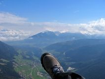 Paragliding. Down the alps Royalty Free Stock Images