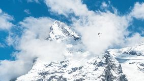 Paragliding above the Alp mountains Stock Images