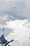 Paragliding above snow covered mountains in the Alps Stock Photos