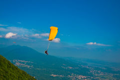 Paragliding above the town Stock Photos