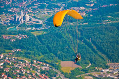 Paragliding above the town Stock Photo