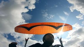 Paragliding activity in sky. Male paraglider is moving against the sky with the vehicle. Male paraglider is moving against the sky with the vehicle. 4K stock footage