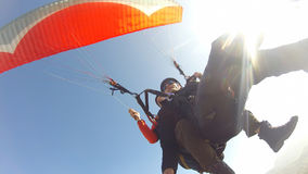 Paragliding against blue sky and sunbeams Stock Photos
