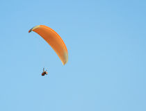 Paragliding against clear blue sky Stock Photography