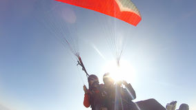 Paragliding against sunshine Royalty Free Stock Photos