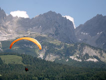 Paragliding in the alps. A paraglider at the Wilder Kaiser mountains in Austria stock photography
