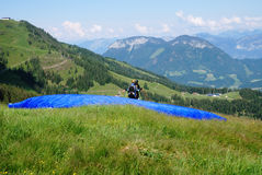 Paragliding in the alps. Paraglider just before the start royalty free stock images