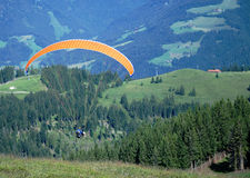 Paragliding in the alps. Paragliding in the mountains of Austria stock photos