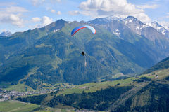 Paragliding in the alps Stock Photo