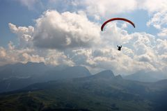 Paragliding on alps royalty free stock photos