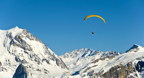 Paragliding in the Alps in winter Royalty Free Stock Images
