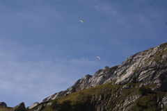 Paragliding as viewed from the ground Royalty Free Stock Photo