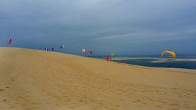 Paragliding on the beach at Dune du Pilat, France Atlantic Ocean stock image