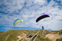 Paragliding in the beach stock image