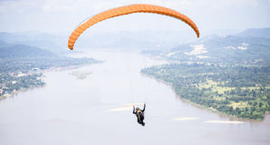 Paragliding in beautiful mountains with river Stock Photos
