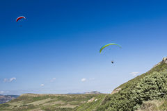 Paragliding in blue cloudy sky royalty free stock photography