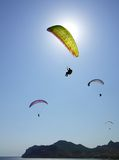 Paragliding in the blue sky Royalty Free Stock Image