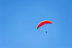 Paragliding on blue sky Stock Photography