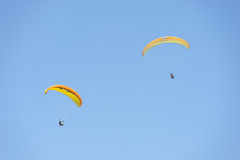 Paragliding in blue sky Stock Image