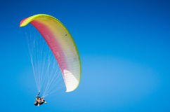 Paragliding in the blue sky. Paragliding in the clear blue sky Royalty Free Stock Images