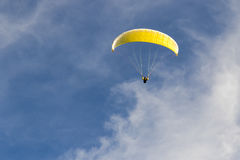 Paragliding in the blue sky Stock Images